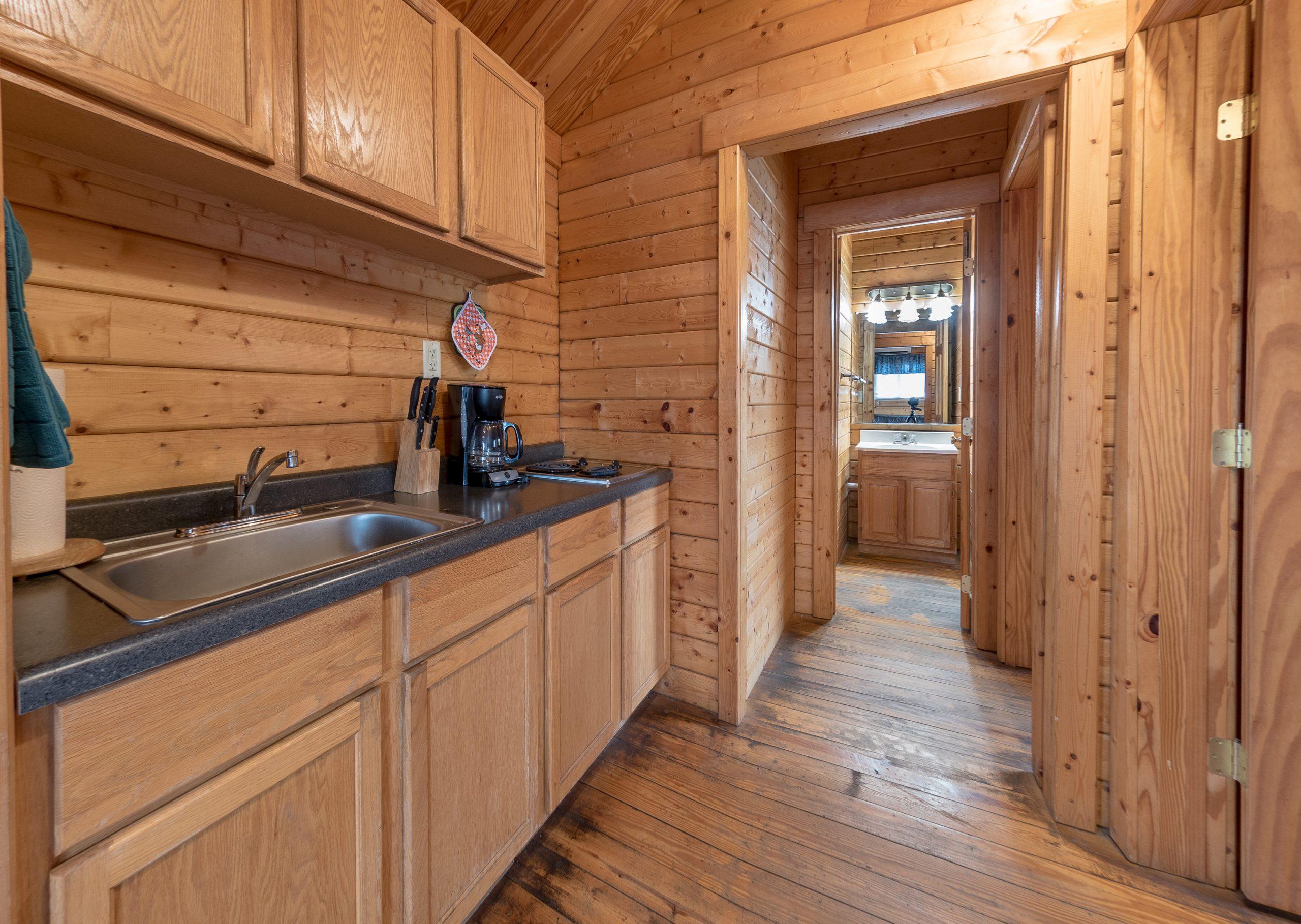 Cottage kitchenette, sink, coffee maker and two burner range